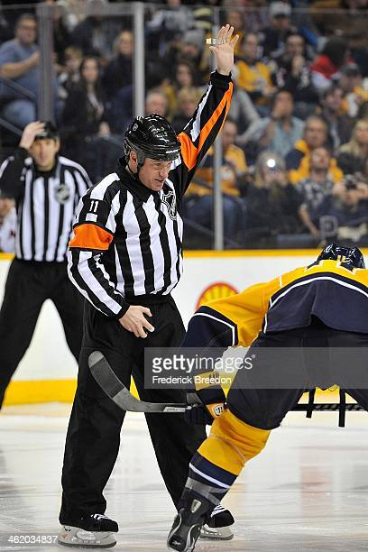 Referee Kelly Sutherland officiates a game between the Ottawa Senators and the Nashville Predators at Bridgestone Arena on January 11 2014 in...