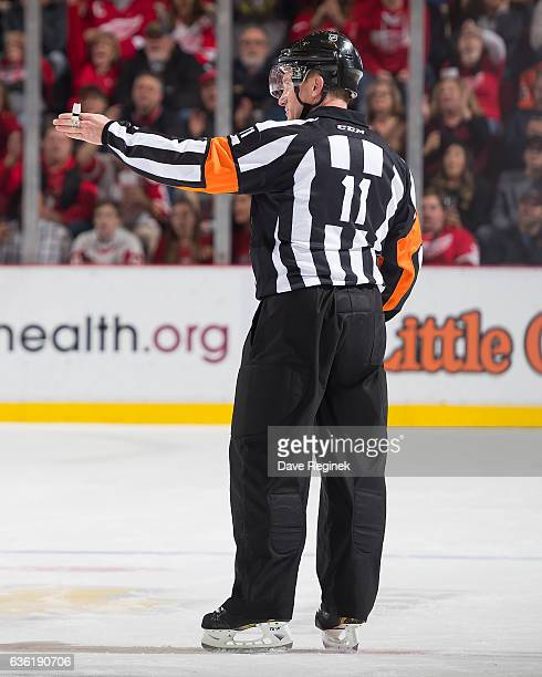 Referee Kelly Sutherland points to center ice for a good goal after a video review during an NHL game between the Detroit Red Wings and the Anaheim...