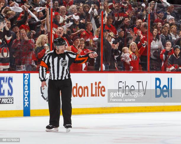 Referee Kelly Sutherland signals a good goal at centre ice after a review in Game Five of the Eastern Conference Second Round opposing the Ottawa...