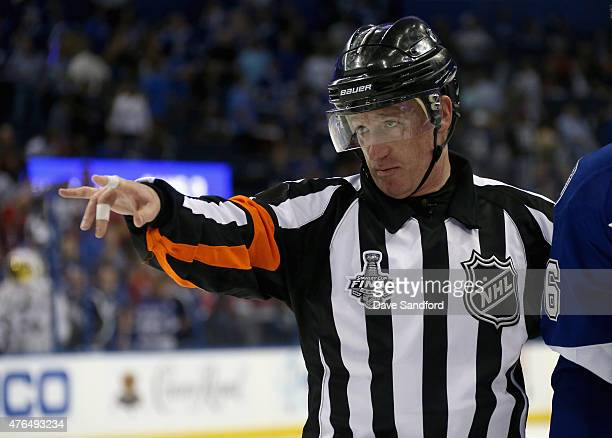 Referee Kelly Sutherland signals during Game Two of the 2015 NHL Stanley Cup Final between the Chicago Blackhawks and the Tampa Bay Lightning at...