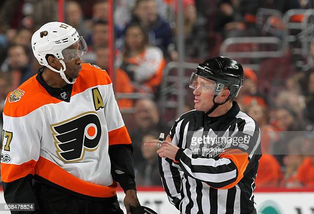 Referee Kelly Sutherland speaks with Wayne Simmonds of the Philadelphia Flyers during a stoppage in play against the Tampa Bay Lightning on January 7...