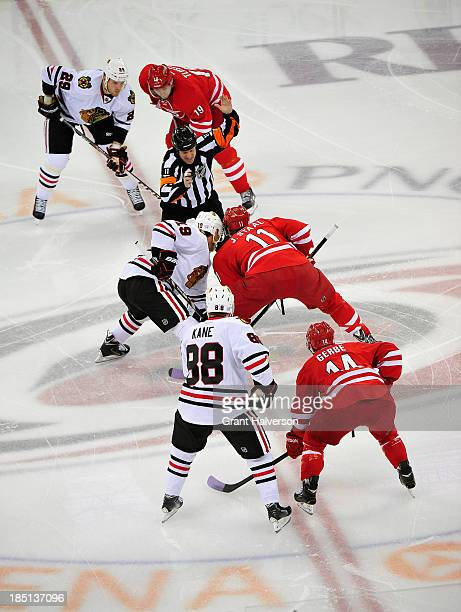 NHL referee Kelly Sutherland steps into the faceoff circle during a game between the Chicago Blackhawks and the Carolina Hurricanes during play at...