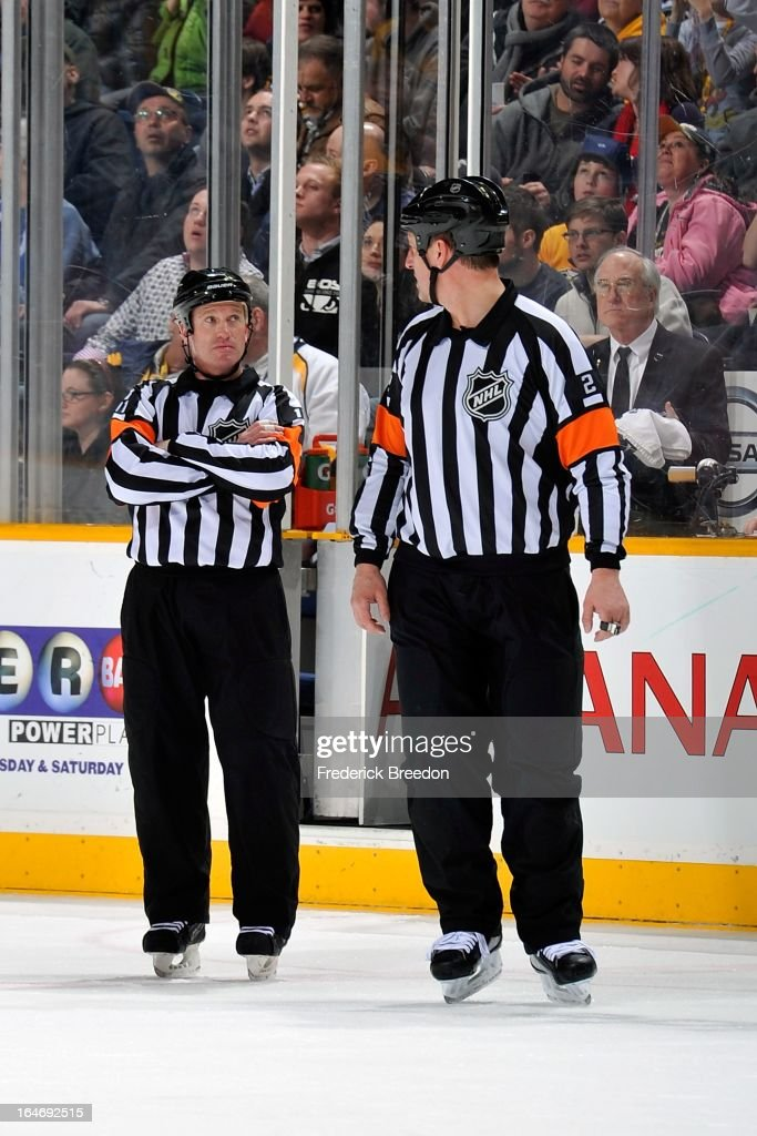 Referee <a gi-track='captionPersonalityLinkClicked' href=/galleries/search?phrase=Kelly+Sutherland&family=editorial&specificpeople=804878 ng-click='$event.stopPropagation()'>Kelly Sutherland</a> #11 talks to Mike Hasenfratz #2 during a timeout between the Nashville Predators and the Edmonton Oilers at the Bridgestone Arena on March 25, 2013 in Nashville, Tennessee.