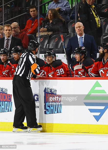 Referee Kelly Sutherland talks to New Jersey Devils Head Coach John Hynes during the secondperiod of the game against the Los Angeles Kings at...