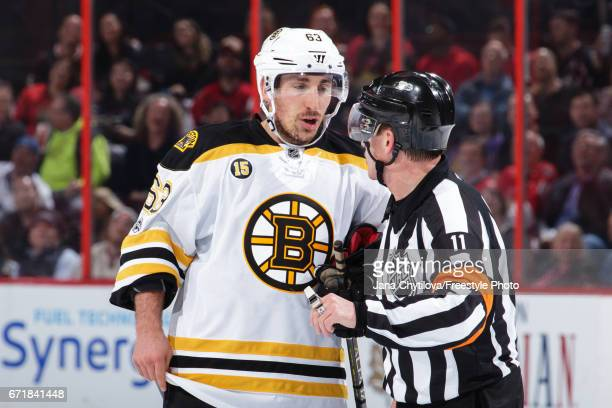 Referee Kelly Sutherland talks with Brad Marchand of the Boston Bruins during a stoppage in play against the Ottawa Senators in Game Five of the...