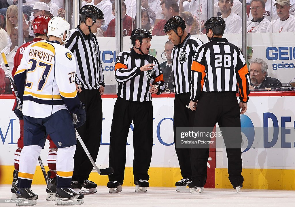 Referee <a gi-track='captionPersonalityLinkClicked' href=/galleries/search?phrase=Kelly+Sutherland&family=editorial&specificpeople=804878 ng-click='$event.stopPropagation()'>Kelly Sutherland</a> (C) talks with linesman <a gi-track='captionPersonalityLinkClicked' href=/galleries/search?phrase=Jay+Sharrers&family=editorial&specificpeople=619671 ng-click='$event.stopPropagation()'>Jay Sharrers</a> over a reviewed goal in Game One of the Western Conference Semifinals between the Nashville Predators and the Phoenix Coyotes during the 2012 NHL Stanley Cup Playoffs at Jobing.com Arena on April 27, 2012 in Glendale, Arizona. The Coyotes defeated the Predators 4-3 in overtime.