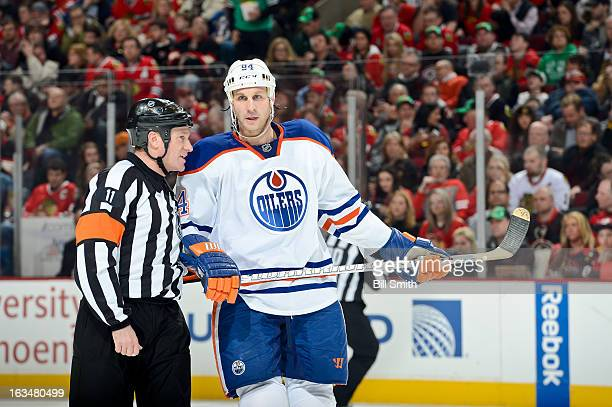 Referee Kelly Sutherland talks with Ryan Smyth of the Edmonton Oilers during the NHL game against the Chicago Blackhawks on March 10 2013 at the...