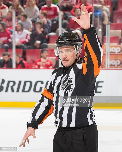 Referee Kelly Sutherland watches the lines changes during an NHL game between the Detroit Red Wings and the Anaheim Ducks at Joe Louis Arena on...