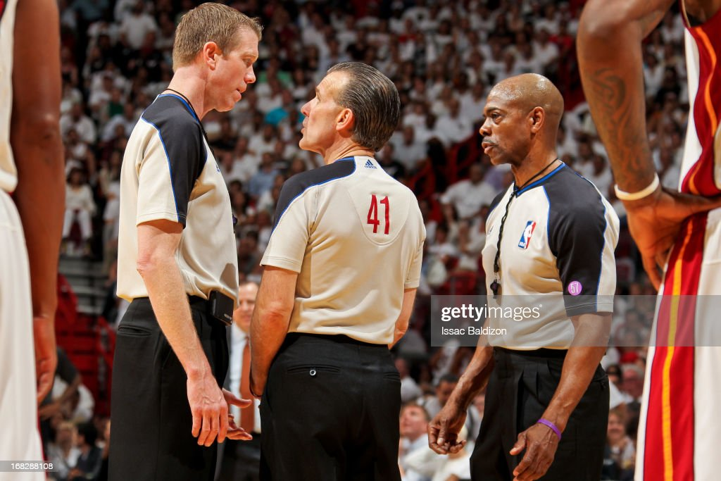 Referee Ken Mauer #41 confers with other referees while officiating between the Chicago Bulls and Miami Heat in Game One of the Eastern Conference Semifinals during the 2013 NBA Playoffs on May 6, 2013 at American Airlines Arena in Miami, Florida.