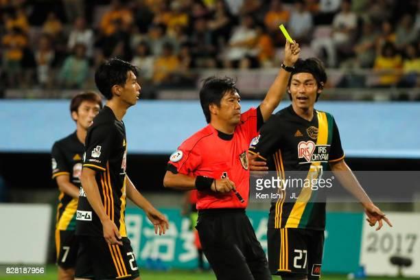 Referee Kenji Ogiya shows a yellow card during the JLeague J1 match between Vegalta Sendai and Jubilo Iwata at Yurtec Stadium Sendai on August 9 2017...