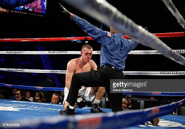 Referee Kenny Bayless counts out Tommy Karpency during his light heavyweight fight against Oleksandr Gvozdyk of Ukraine at MGM Grand Garden Arena on...