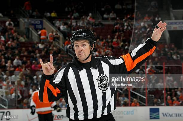 NHL referee Kerry Fraser looks on during a line change in the preseason NHL game between the Philadelphia Flyers and the Minnesota Wild at the...