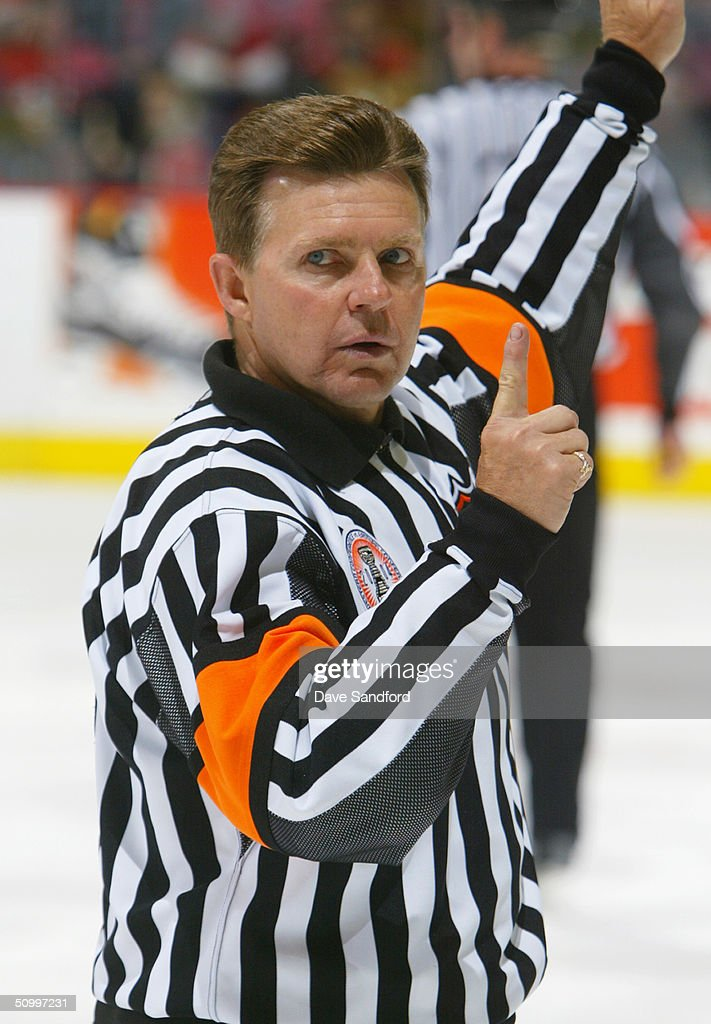 Referee Kerry Fraser #2 signals a stoppage of play in Game Four of the NHL Stanley Cup Finals between the Calgary Flames and the Tampa Bay Lightning on May 31, 2004 at the Pengrowth Saddledome in Calgary, Canada. The Lightning defeated the Flames 1-0.