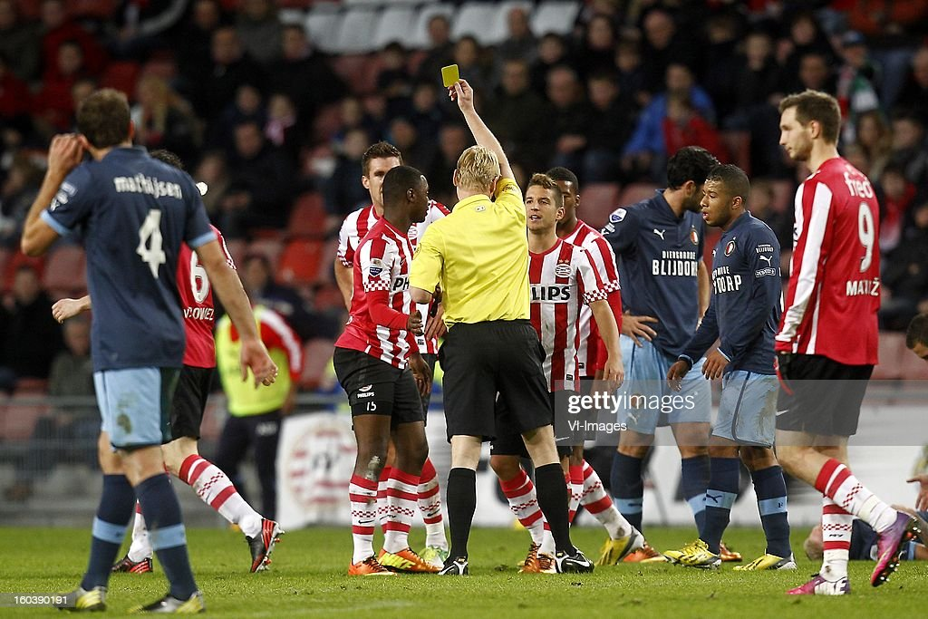 Referee Kevin Blom (C), Jetro Willems of PSV (CL), Dries Mertens of PSV (CR) during the Dutch Cup match between PSV Eindhoven and Feyenoord at the Philips Stadium on january 30, 2013 in Eindhoven, The Netherlands