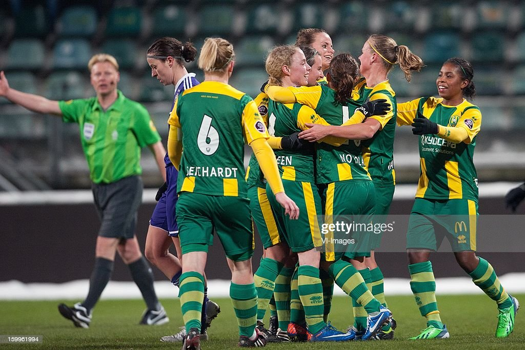 referee Kevin Blom, Luceinne Reichardt of ADO Den Haag, Paola van der Veen of ADO Den Haag, Teresa Noyola of ADO Den Haag, Renate Jansen of ADO Den Haag, Kitty Susan of ADO Den Haag, Sheila van den Bulk of ADO Den Haag, Lineth Beerensteyn of ADO Den Haag during the women BeNe league match between ADO Den Haag and RSC Anderlecht on January 24, 2013 at the Kyocera stadium at The Hague, Netherlands.