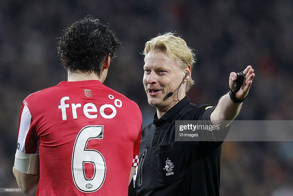 Referee Kevin Blom (R), Mark van Bommel of PSV (L) during the Dutch Eredivisie match between PSV Eindhoven and VVV-Venlo at Philips Stadium on march 02, 2013 in Eindhoven, The Netherlands