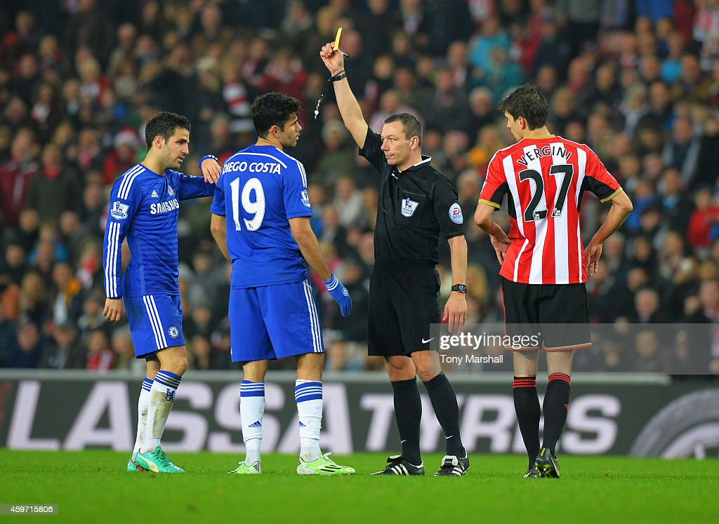 Referee kevin Friedn shows a yellow card to Diego Costa of Chelsea after a clash with Wes Brown of Sunderland during the Barclays Premier League...