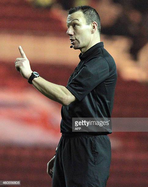 Referee Kevin Friend gestures during the English FA cup third round football match between Middlesbrough and Hull City at the Riverside Stadium in...