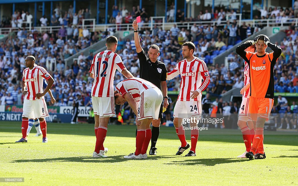 Referee Kevin Friend shows the red card to <a gi-track='captionPersonalityLinkClicked' href=/galleries/search?phrase=Dean+Whitehead&family=editorial&specificpeople=185232 ng-click='$event.stopPropagation()'>Dean Whitehead</a> of Stoke City during the Barclays Premier League match between Reading and Stoke City at Madejski Stadium on August 18, 2012 in Reading, England.