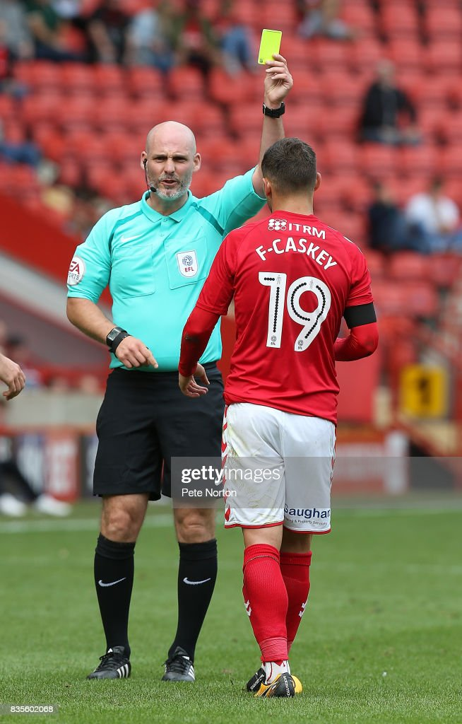 Referee Kevin Johnson shows a yellow card to Jake Forster-Casky of Charlton Athletic during the Sky Bet League One match between Charlton Athletic and Northampton Town at The Valley on August 19, 2017 in London, England.