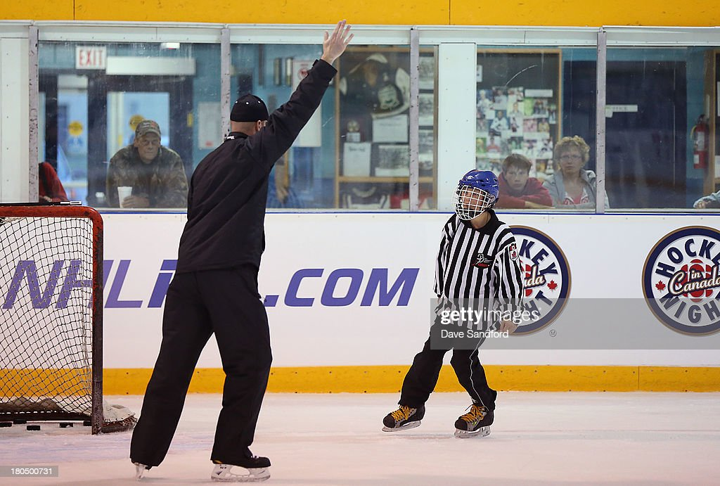 Referee Kevin Pollock instructs local minor league officials as they partake in the NHL Officials Clinic at the Stirling and District Recreation Centre during Kraft Hockeyville Day 1 on September 13, 2013 in Stirling, Ontario, Canada.