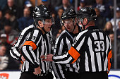 Referee Kevin Pollock referee Brad Watson linesman Matt MacPherson and linesman Brian Mach discus a call during game action on January 23 2016 at Air...