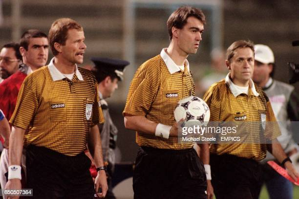 Referee Kim Milton Neilsen and his assistants either side
