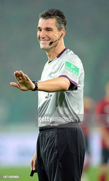 Referee Knut Kircher gestures during the Bundesliga match between Hannover 96 and Eintracht Braunschweig at HDIArena on November 8 2013 in Hanover...