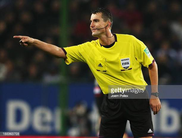 Referee Knut Kircher gestures during the Bundesliga match between Hamburger SV and FC Bayern Muenchen at Imtech Arena on November 3 2012 in Hamburg...