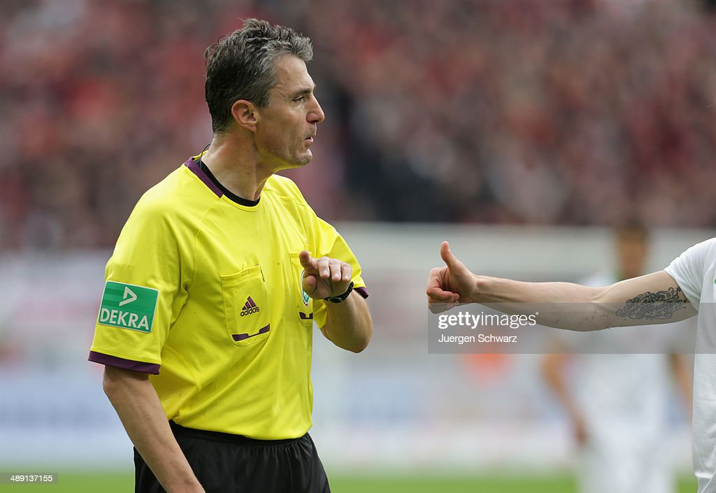 Referee Knut Kircher gives instructions during the Bundesliga match between Bayer 04 Leverkusen and Werder Bremen at BayArena on May 10, 2014 in Leverkusen, Germany.