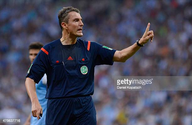 Referee Knut Kircher reacts during the 2 Bundesliga playoff second leg match between 1860 Muenchen and Holstein Kiel at Allianz Arena on June 2 2015...