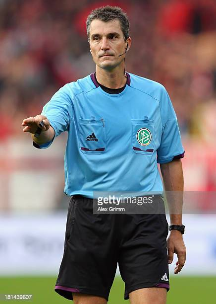 Referee Knut Kircher reacts during the Bundesliga match between 1 FC Nuernberg and Borussia Dortmund at Grundig Stadium on September 21 2013 in...