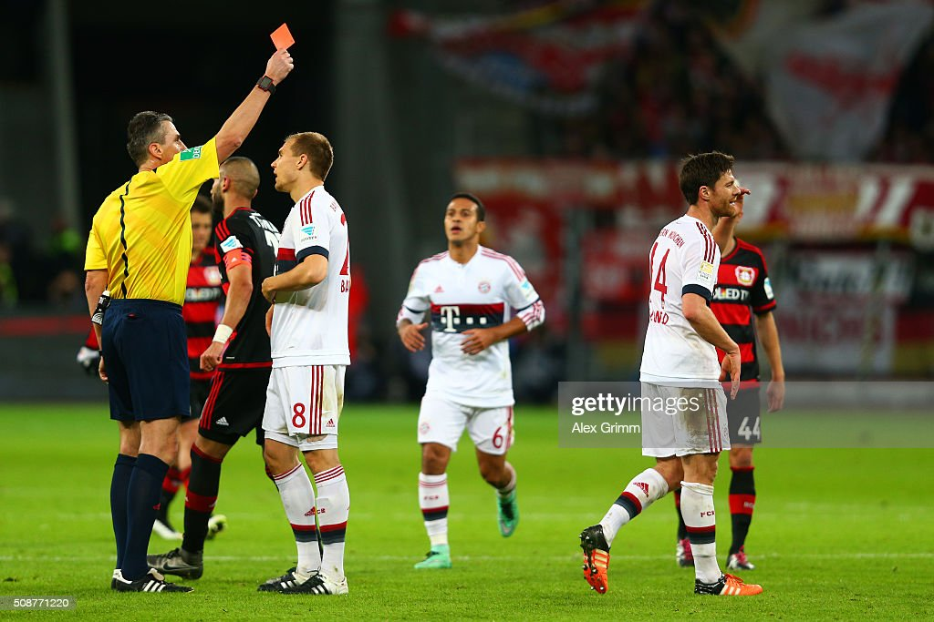 Referee <a gi-track='captionPersonalityLinkClicked' href=/galleries/search?phrase=Knut+Kircher&family=editorial&specificpeople=645627 ng-click='$event.stopPropagation()'>Knut Kircher</a> shows a red card to <a gi-track='captionPersonalityLinkClicked' href=/galleries/search?phrase=Xabi+Alonso&family=editorial&specificpeople=213833 ng-click='$event.stopPropagation()'>Xabi Alonso</a> of FC Bayern Muenchen during the Bundesliga match between Bayer Leverkusen and FC Bayern Muenchen at BayArena on February 6, 2016 in Leverkusen, Germany.