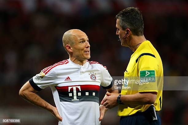 Referee Knut Kircher speaks with Arjen Robben of FC Bayern Muenchen during the Bundesliga match between Bayer Leverkusen and FC Bayern Muenchen at...