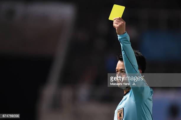 Referee Koichiro Fukushima shows an yellow card to Evson of Kamatamare Sanuki during the JLeague J2 match between Matsumoto Yamaga and Kamatamare...