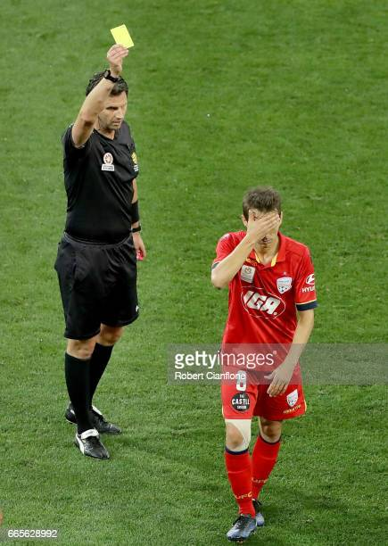 Referee Kris GriffithJones shows the yellow card to Isaias of United during the round 26 ALeague match between Melbourne City FC and Adelaide United...