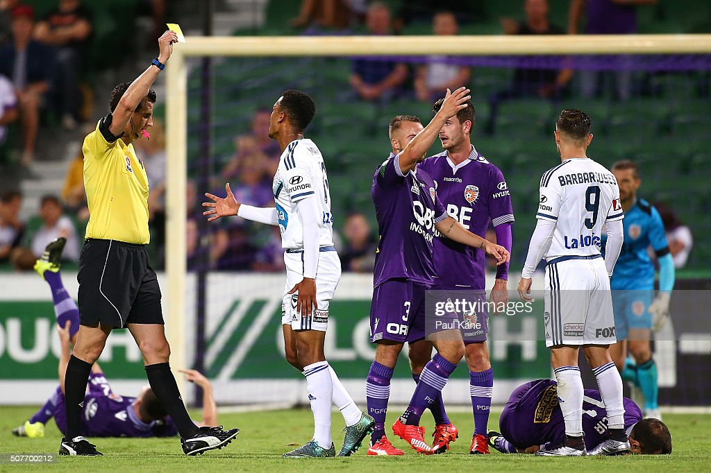Referee Kris Griffiths-Jones shows the yellow card to Rashid Mahazi of the Victory after a challenge on Richard Garcia of the Glory during the round 17 A-League match between Perth Glory and Melbourne Victory at nib Stadium on January 30, 2016 in Perth, Australia.
