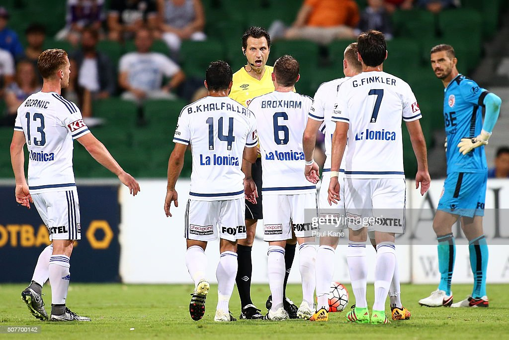 Referee Kris Griffiths-Jones talks with Victory players before issueing Fahid Ben Khalfallah of the Victory a red card during the round 17 A-League match between Perth Glory and Melbourne Victory at nib Stadium on January 30, 2016 in Perth, Australia.