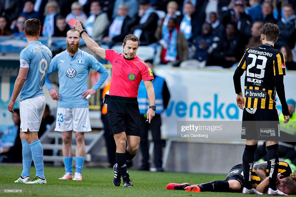 Referee Kristoffer Karlsson give Markus Rosenberg of Malmo FF a red card during the Allsvenskan match between Malmo FF and BK Hacken at Swedbank Stadion on May 1, 2016 in Malmo, Sweden.