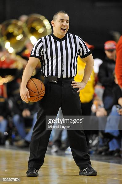 referee-larry-scirotto-looks-on-during-a-college-basketball-game-the-picture-id502507574