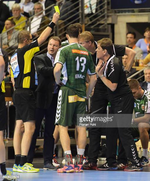 referee Lars Geipel shows coach Velimir Petkovic of Fuechse Berlin the yellow card during the game between Fuechse Berlin and the HC Erlangen on...