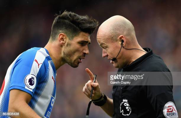 Referee Lee Mason speaks to Christopher Schindler of Huddersfield Town uring the Premier League match between Huddersfield Town and Manchester United...