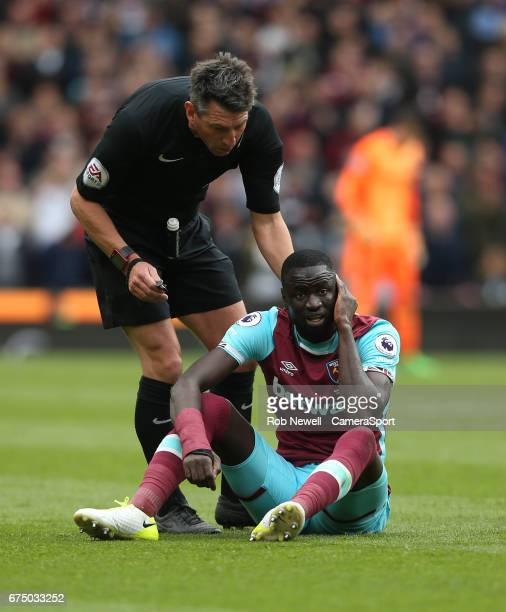 Referee Lee Probert checks on West Ham United's Cheikhou Kouyate during the Premier League match between Stoke City and West Ham United at Bet365...