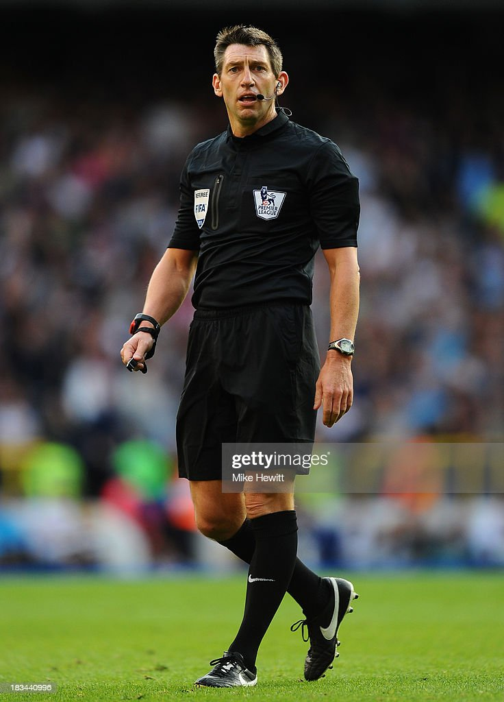 Referee Lee Probert looks on during the Barclays Premier League match between Tottenham Hotspur and West Ham United at White Hart Lane on October 6, 2013 in London, England.