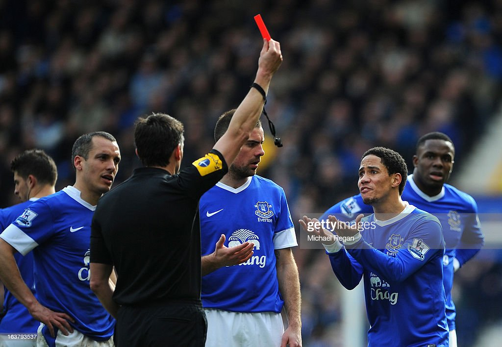 Referee Lee Probert shows a red card to <a gi-track='captionPersonalityLinkClicked' href=/galleries/search?phrase=Steven+Pienaar&family=editorial&specificpeople=787271 ng-click='$event.stopPropagation()'>Steven Pienaar</a> of Everton during the Barclays Premier League match between Everton and Manchester City at Goodison Park on March 16, 2013 in Liverpool, England.
