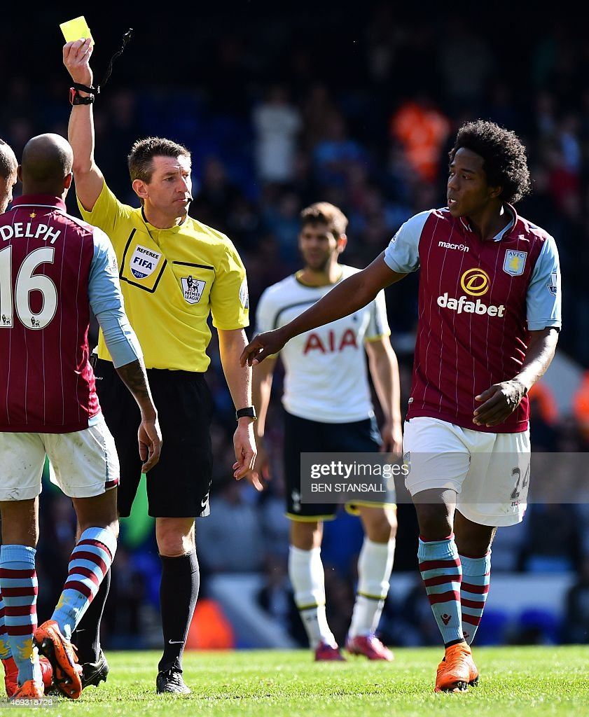 Referee <a gi-track='captionPersonalityLinkClicked' href=/galleries/search?phrase=Lee+Probert&family=editorial&specificpeople=664910 ng-click='$event.stopPropagation()'>Lee Probert</a> (L) shows Aston Villa's Colombian midfielder Carlos Sanchez (R) a yellow card during the English Premier League football match between Tottenham Hotspur and Aston Villa at White Hart Lane in north London on April 11, 2015. USE. No use with unauthorized audio, video, data, fixture lists, club/league logos or live services. Online in-match use limited to 45 images, no video emulation. No use in betting, games or single club/league/player publications