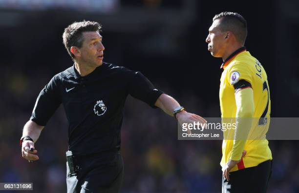 Referee Lee Probert speaks to Jose Holebas of Watford during the Premier League match between Watford and Sunderland at Vicarage Road on April 1 2017...