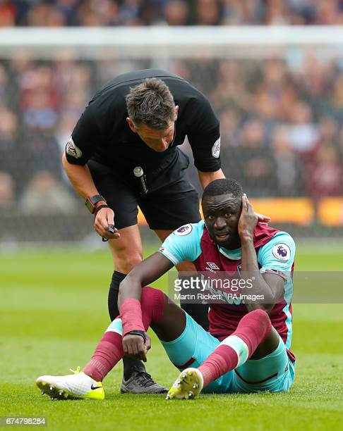 Referee Lee Probert speaks with West Ham United's Cheikhou Kouyate on the ground after a challenge during the Premier League match at the bet365...