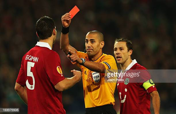 Referee Liran Liany show sthe red card to Mario Eggimann of Hannover during the UEFA Europa League Group L match between Hannover 96 and Levante UD...