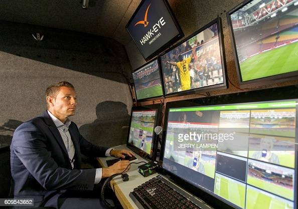 A referee looks at the broadcast of Netherland's Cup football match between Ajax and Willem II in Amsterdam on September 21 2016 Cup match between...